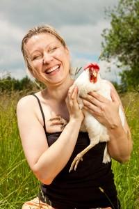 Blonde Beautiful Woman Hugs An White Chicken